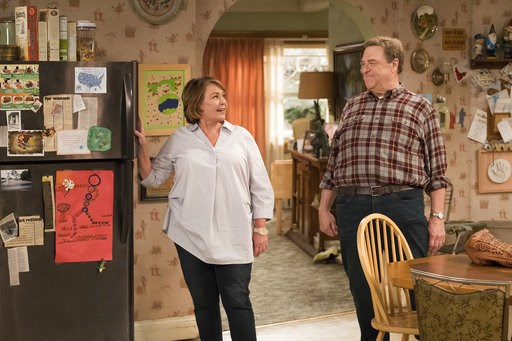 "(Adam Rose/ABC via AP). This image released by ABS shows Roseanne Barr, left, and John Goodman in a scene from the comedy series ""Roseanne."" ABC's ""Roseanne"" revival is in the running for Emmy nominations Thursday, but will TV academy voters overlook i..."