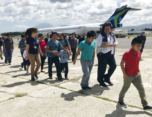 (AP Photo/Colleen Long). Families separated under President Donald Trump administration's zero tolerance policy return home to Guatemala City, Guatemala, Tuesday, July 10, 2018, after being deported from the United States. After lining up on the tarmac...