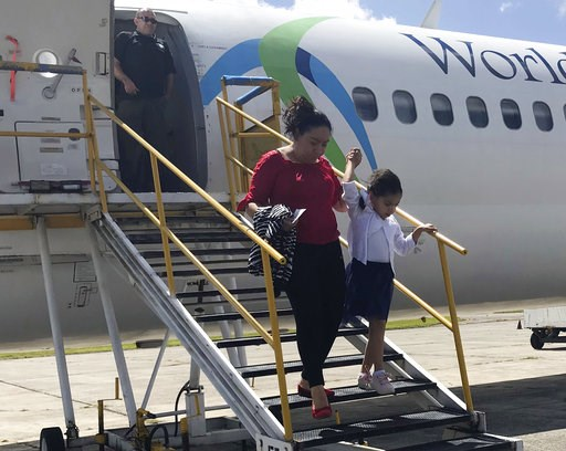(AP Photo/Colleen Long). Donelda Pulex and her 5-year-old daughter Marelyn, step off a chartered flight from the U.S. in Guatemala City, Guatemala, after the two were deported after being separated crossing the U.S. border. Pulex said she was tormented...