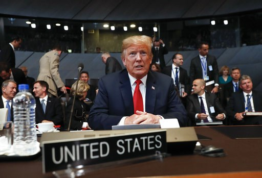(AP Photo/Pablo Martinez Monsivais/pool). U.S. President Donald Trump takes his seat as he attends the multilateral meeting of the North Atlantic Council, Wednesday, July 11, 2018 in Brussels, Belgium.