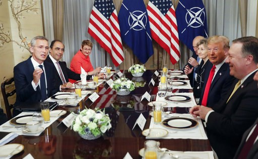 (AP Photo/Pablo Martinez Monsivais). U.S. President Donald Trump, second right, listens to NATO Secretary General Jens Stoltenberg, left, during their bilateral breakfast, Wednesday July 11, 2018 in Brussels, Belgium.