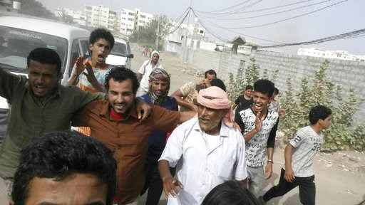(AP Photo, File). FILE - In this Monday, June 25, 2018 file photo, Yemeni actor Nasser al-Anbari, in brown shirt, is greeted by his family and friends after his release from a prison controlled by the United Arab Emirates where he and others had been h...