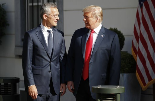(AP Photo/Pablo Martinez Monsivais). U.S. President Donald Trump, right, talks with NATO Secretary General Jens Stoltenberg, left, prior to their bilateral breakfast, Wednesday, July 11, 2018 in Brussels, Belgium.