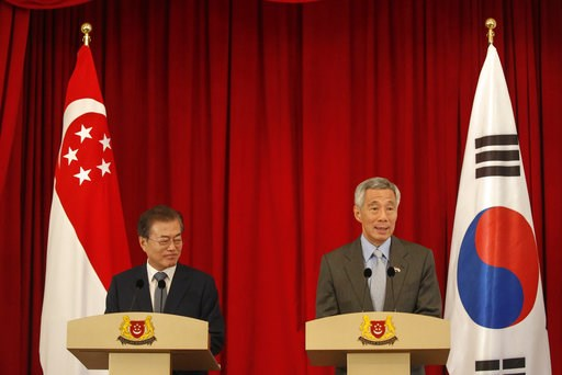(Wallace Woon/Pool Photo via AP). South Korea President Moon Jae-in, left, and Singapore Prime Minister Lee Hsien Loong hold a press conference at the Istana Presidential Palace in Singapore, Thursday, July 12, 2018. Moon is on a three-day visit to Sin...