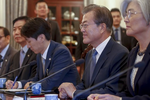 (Wallace Woon/Pool Photo via AP). South Korea President Moon Jae-in, second from right, talks with Singapore Prime Minister Lee Hsien Loong, during their meeting at the Istana Presidential Palace in Singapore Thursday, July 12, 2018. Moon is on a three...
