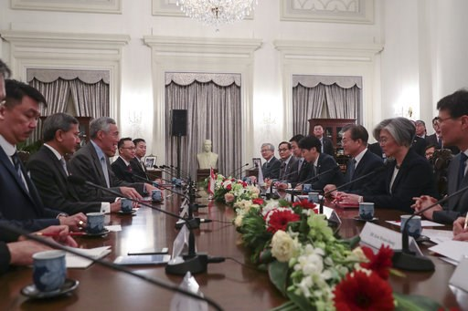 (Wallace Woon/Pool Photo via AP). Singapore Prime Minister Lee Hsien Loong, third from left, and South Korea President Moon Jae-in, third from right, attend a meeting with their respective delegations at the Istana Presidential Palace in Singapore, Thu...