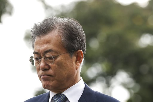 (AP Photo/Yong Teck Lim). South Korea's President Moon Jae-in arrives at the Istana or Presidential Palace in Singapore, Thursday, July 12, 2018.
