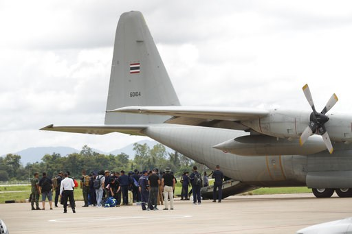 (AP Photo/Vincent Thian). Thai Navy SEALs and military personnel board a plane at the airport in Chiang Rai, northern Thailand, Thursday, July 12, 2018. A daring rescue mission in the treacherous confines of a flooded cave in northern Thailand has save...