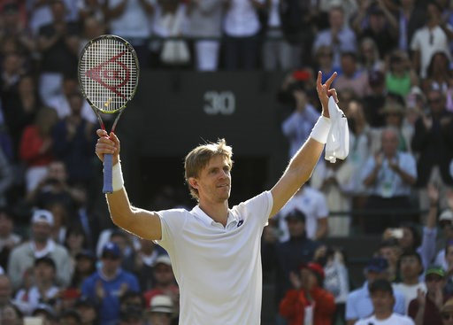 (AP Photo/Ben Curtis). Kevin Anderson of South Africa celebrates winning his men's quarterfinals match against Switzerland's Roger Federer, at the Wimbledon Tennis Championships, in London, Wednesday July 11, 2018.