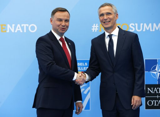 (AP Photo/Francois Mori). Poland's President Andrzej Duda is greeted by NATO Secretary General Jens Stoltenberg before a summit of heads of state and government at NATO headquarters in Brussels on Wednesday, July 11, 2018. NATO leaders gather in Brusse...