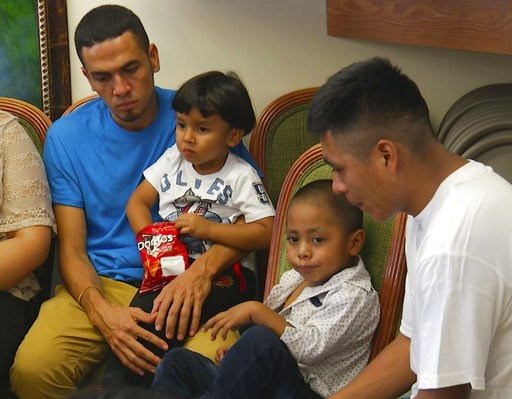 (AP Photo/Robert Bumsted). In this image taken from video, Javier Garrido Martinez, left and Alan Garcia, right, sit with their 4-year-sons at a news conference in New York, Wednesday, July 11, 2018. They men were reunited with their children after alm...