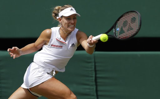 (AP Photo/Kirsty Wigglesworth). Germany's Angelique Kerber returns the ball to Latvia's Jelena Ostapenko during their women's singles semifinals match at the Wimbledon Tennis Championships, in London, Thursday July 12, 2018.