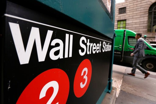 (AP Photo/Richard Drew, File). FILE- In this April 5, 2018, file photo, a sign for a Wall Street subway station is shown in New York. The U.S. stock market opens at 9:30 a.m. EDT on Thursday, July 12.