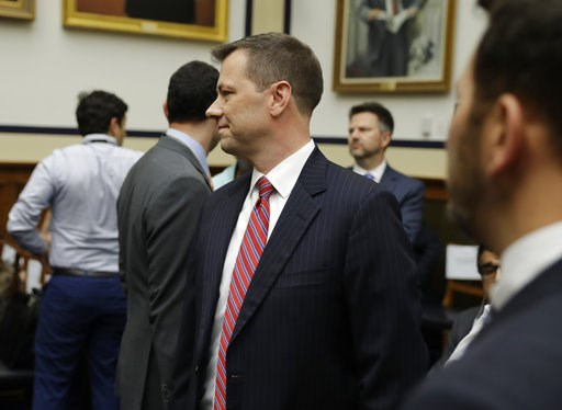 "(AP Photo/Evan Vucci). FBI Deputy Assistant Director Peter Strzok, center, arrives to a hearing of the House Committees on the Judiciary and Oversight and Government Reform on ""Oversight of FBI and DOJ Actions Surrounding the 2016 Election,"" on Capitol..."