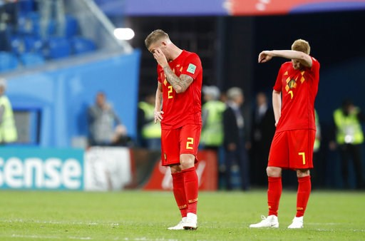 (AP Photo/David Vincent). Belgium's Toby Alderweireld, left, and Belgium's Kevin De Bruyne stand on the pitch at the end of the semifinal match between France and Belgium at the 2018 soccer World Cup in the St. Petersburg Stadium, in St. Petersburg, Ru...