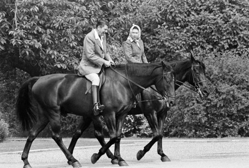 (AP Photo/Bob Daugherty, File). FILE - In this June 8, 1982 file photo, U.S. President Ronald Reagan, on Centennial, and Britain's Queen Elizabeth II, on Burmese, go horseback riding in the grounds of Windsor Castle, England. US President Trump enjoys ...