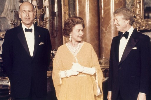 (AP Photo, File). FILE - In this file photo dated  May 1977, U.S. President Jimmy Carter, right, and Britain's Queen Elizabeth II with French President Valery Giscard d'Estaing, at Buckingham Palace in London. US President Trump enjoys flouting diploma...
