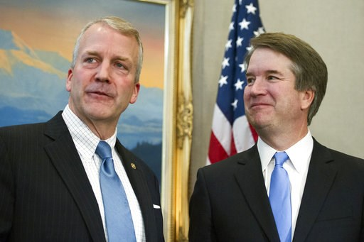 (AP Photo/Cliff Owen). Supreme Court nominee Brett Kavanaugh, right, stands with Sen. Dan Sullivan, R-Alaska, before the start of their meeting, Thursday, July 12, 2018, on Capitol Hill in Washington.