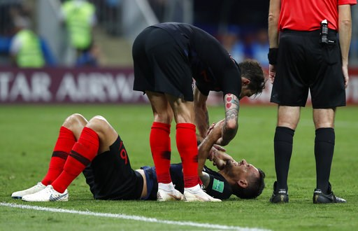 (AP Photo/Rebecca Blackwell). Croatia's Dejan Lovren lies on the pitch during the semifinal match between Croatia and England at the 2018 soccer World Cup in the Luzhniki Stadium in Moscow, Russia, Wednesday, July 11, 2018.