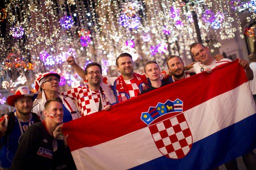 (AP Photo/Alexander Zemlianichenko). Croatia fans celebrate their team victory after the semifinal soccer match between Croatia and England during the 2018 soccer World Cup in Nikolskaya street near the Kremlin in Moscow, Russia, Thursday, July 12, 2018.