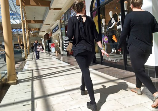 (AP Photo/Elise Amendola, File). FILE- In this April 9, 2018, file photo, shoppers walk in a mall in Salem, N.H. As Amazon gears up for its Prime Day promotion, other big-name retailers like Macy's and eBay are launching deals and sales of their own. B...