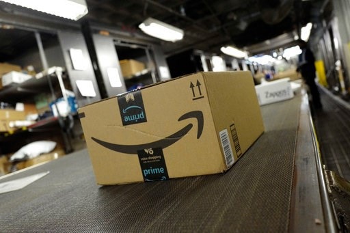 (AP Photo/Mark Lennihan, File). FILE- In this May 9, 2017, file photo, a package from Amazon Prime moves on a conveyor belt at a UPS facility in New York. Amazon's Prime Day starts July 16, 2018, and will be six hours longer than last year's and will l...