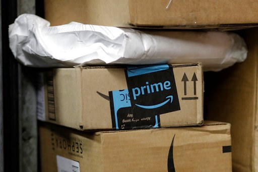 (AP Photo/Mark Lennihan, File). FILE- In this May 9, 2017, file photo, a package from Amazon Prime is loaded for delivery in New York.  Amazon's Prime Day starts July 16, 2018, and will be six hours longer than last year's and will launch new products.