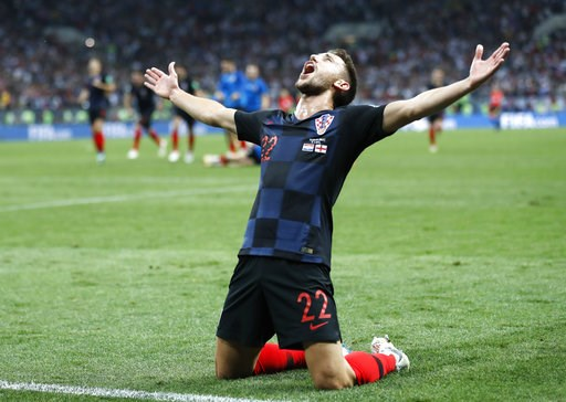 (AP Photo/Frank Augstein). Croatia's Josip Pivaric celebrates after his team advanced to the final during the semifinal match between Croatia and England at the 2018 soccer World Cup in the Luzhniki Stadium in Moscow, Russia, Wednesday, July 11, 2018.