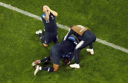 (AP Photo/Dmitri Lovetsky). France players celebrate their victory after the the semifinal match between France and Belgium at the 2018 soccer World Cup in the St. Petersburg Stadium in St. Petersburg, Russia, Tuesday, July 10, 2018.