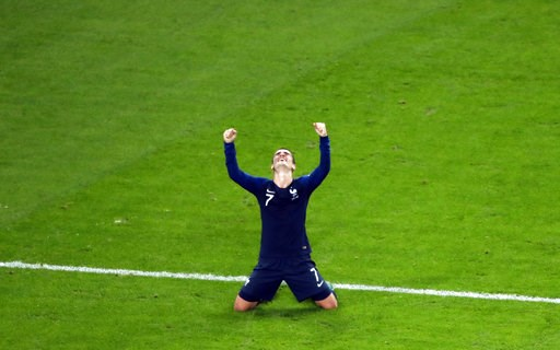 (AP Photo/Pavel Golovkin). France's Antoine Griezmann celebrates at the end of the semifinal match between France and Belgium at the 2018 soccer World Cup in the St. Petersburg Stadium in St. Petersburg, Russia, Tuesday, July 10, 2018.
