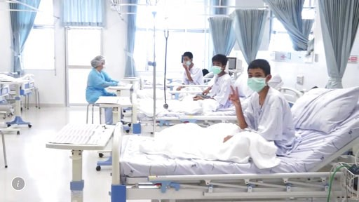 (Thailand Government Spokesman Bureau via AP). In this image made from video, released by the Thailand Government Spokesman Bureau, three of the 12 boys are seen recovering in their hospital beds after being rescued along with their coach from a floode...