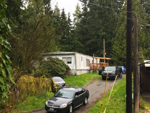 (Christine Willmsen/The Seattle Times via AP, File). FILE - In this March 12, 2018, file photo, authorities stand by the home of Thanh Cong Phan in Everett, Wash. A federal judge is expected to decide Thursday, July 12, 2018, whether a Washington state...