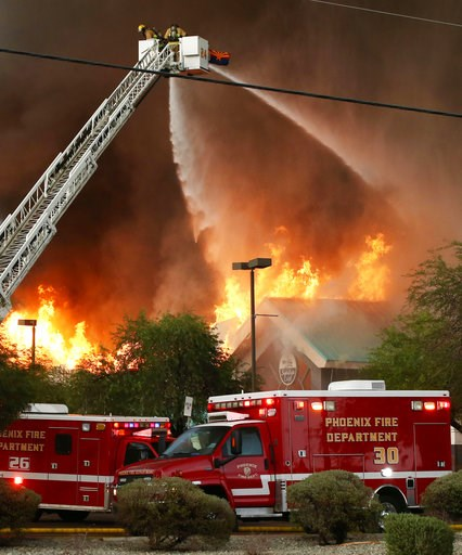 (AP Photo/Rob Schumacher/The Arizona Republic). Phoenix and Glendale, Arizona fire departments battle a fire Wednesday, July 11, 2018 in Phoenix. The fire gutted a supermarket in west-central Phoenix during a heavy rainstorm storm Wednesday evening and...
