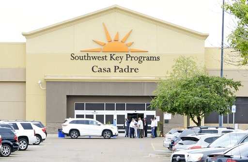 (Miguel Roberts /The Brownsville Herald via AP, File). FILE - In this June 18, 2018 file photo, dignitaries take a tour of Southwest Key Programs Casa Padre, a U.S. immigration facility in Brownsville, Texas, where children who have been separated from...