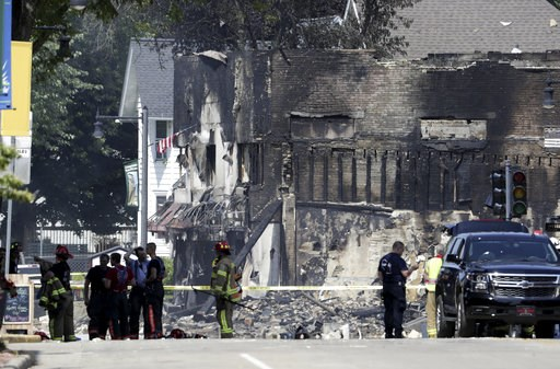 (Steve Apps/Wisconsin State Journal via AP). A large swath of downtown Sun Prairie remains closed Wednesday morning, July 11, 2018 in the wake of a gas leak explosion Tuesday evening that leveled a downtown Sun Prairie bar, caused a massive fire at a p...