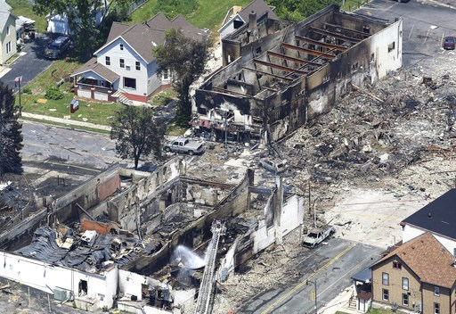 (John Hart/Wisconsin State Journal via AP). In a view looking northwest from above, the aftermath of a gas explosion in downtown Sun Prairie, Wis., is seen Wednesday, July 11, 2018. At the top right of the image is the site of the former Barr House whe...