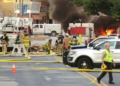 (Amber Arnold/Wisconsin State Journal via AP). Authorities work the scene of an explosion in downtown Sun Prairie, Wis., Tuesday, July 10, 2018. The explosion rocked the downtown area of Sun Prairie, a suburb of Madison, after a contractor struck a nat...