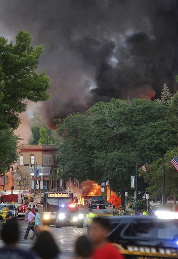 (Amber Arnold/Wisconsin State Journal via AP). Smoke rises as firefighters work the scene of an explosion in downtown Sun Prairie, Wis., Tuesday, July 10, 2018. The explosion rocked the downtown area of Sun Prairie, a suburb of Madison, after a contrac...
