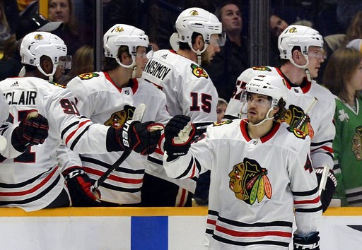 (AP Photo/Mark Zaleski, File). FILE - In this Jan. 30, 2018, file photo, Chicago Blackhawks left wing Vinnie Hinostroza (48) is congratulated after scoring a goal against the Nashville Predators during the second period of an NHL hockey game, in Nashvi...