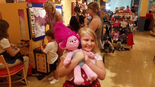 (Douglas R. Clifford/Tampa Bay Times via AP). Eight-year-old Skylar Baughey, of Clearwater, Fla., hugs her troll moments after completing its construction at the Build-A-Bear Workshop at Westfield Countryside Mall Thursday, July 12, 2018, in Clearwater...
