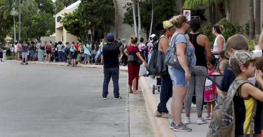 (Carline Jean/South Florida Sun-Sentinel via AP). Parents and kids wait in line for close to an hour at Coral Square mall in Coral Springs, Fla., for the Build-A-Bear Workshop Pay Your Age day event Thursday, July 12, 2018. Customers were allowed custo...