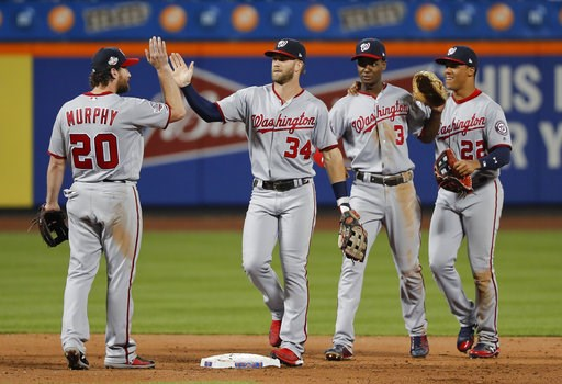 (AP Photo/Julie Jacobson). The Washington Nationals celebrate after defeating the New York Mets 5-4 in a baseball game Thursday, July 12, 2018, in New York.
