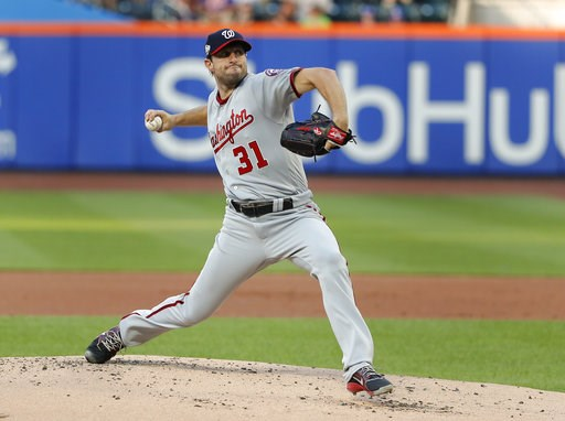 (AP Photo/Julie Jacobson). Washington Nationals starting pitcher Max Scherzer delivers against the New York Mets during the first inning of a baseball game Thursday, July 12, 2018, in New York.