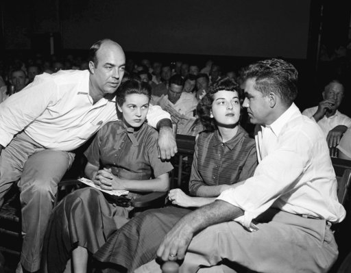 (AP Photo, File). FILE - In this Sept. 23, 1955, file photo, J.W. Milam, left, his wife, second left, Roy Bryant, far right, and his wife, Carolyn Bryant, sit together in a courtroom in Sumner, Miss. Bryant and his half-brother Milam were charged with ...