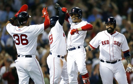 (AP Photo/Michael Dwyer). Boston Red Sox's Mookie Betts, center right, celebrates his grand slam that drove in Eduardo Nunez (36), Jackie Bradley Jr., center left, and Sandy Leon during the fourth inning of a baseball game against the Toronto Blue Jays...