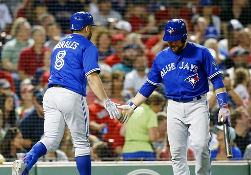 (AP Photo/Michael Dwyer). Toronto Blue Jays' Kendrys Morales (8) celebrates his solo home run with Russell Martin during the seventh inning of the team's baseball game against the Boston Red Sox in Boston, Thursday, July 12, 2018.