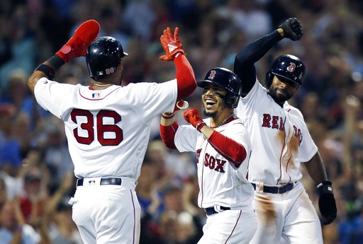 (AP Photo/Michael Dwyer). Boston Red Sox's Mookie Betts, center, celebrates his grand slam that also drove in Eduardo Nunez (36) and Jackie Bradley Jr., right, during the fourth inning of a baseball game against the Toronto Blue Jays in Boston, Thursda...