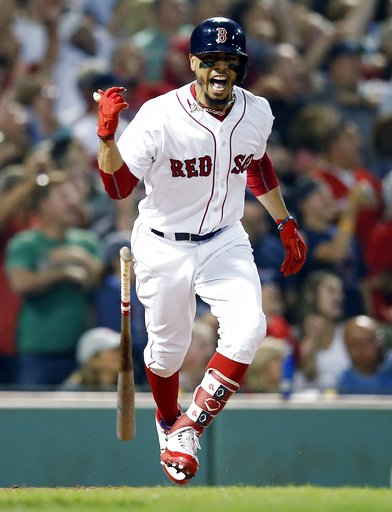 (AP Photo/Michael Dwyer). Boston Red Sox's Mookie Betts reacts to his grand slam during the fourth inning of a baseball game against the Toronto Blue Jays in Boston, Thursday, July 12, 2018.