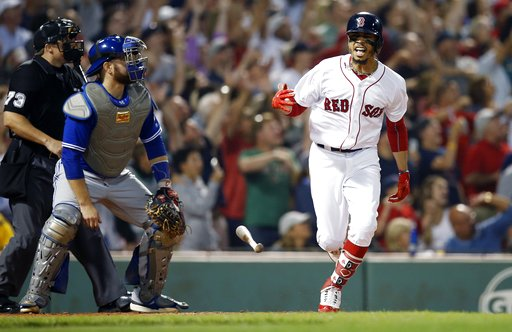 (AP Photo/Michael Dwyer). Boston Red Sox's Mookie Betts reacts in front of Toronto Blue Jays' Russell Martin, left, after hitting a grand slam during the fourth inning of a baseball game in Boston, Thursday, July 12, 2018.