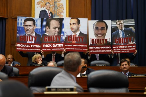 "(AP Photo/Evan Vucci). Staff members hold up posters in a House Committees on the Judiciary and Oversight and Government Reform hearing on ""Oversight of FBI and DOJ Actions Surrounding the 2016 Election"" with FBI Deputy Assistant Director Peter Strzok,..."